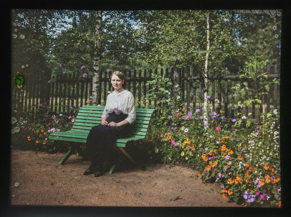 Helka, sister of Reino Pietinen, among a profusion of flowers. Photo: Reino Pietinen / Picture Collections of the Finnish Heritage Agency